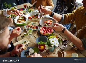 stock-photo-people-sitting-at-dining-table-and-eating-427193719