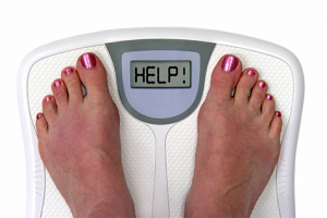 weight-loss-standing-on-scales